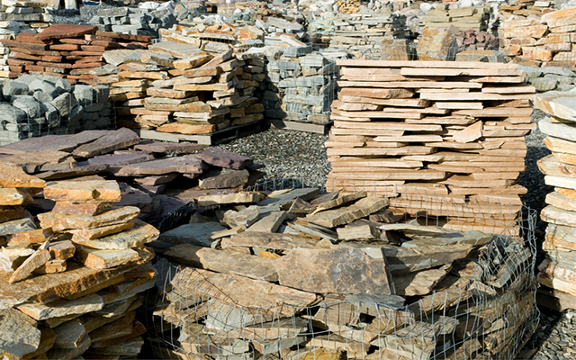 Stacked landscaping rock on pallets.