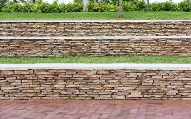 Stone retaining walls in terraced layers
